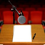 seminar preparation with microphone and podium